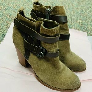 Brown heeled boots with buckled design